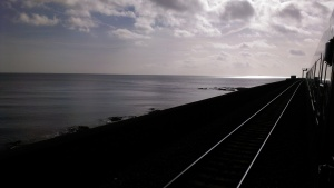 The line runs alongside the sea at Dawlish.  That sleeping sea when awake thrashes the passing trains.